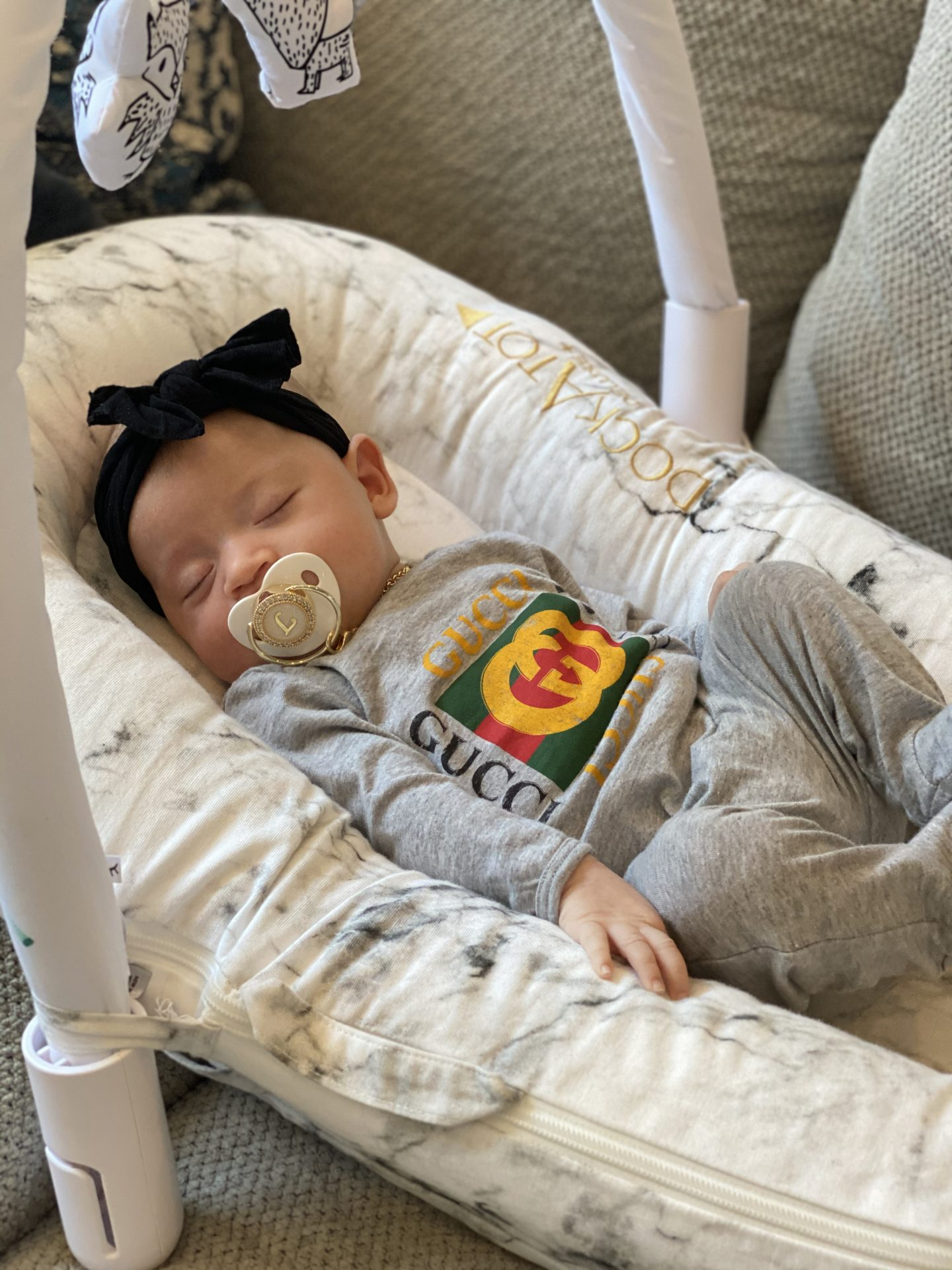 baby items, baby must haves, moms favorite baby items, newborn baby, baby gear, baby items, newborn must haves, mom of two, mom blogger, mommy blogger, motherhood, Chicago mom, dock-a-tot, snoo, fisher price, doona, magic merlin suit